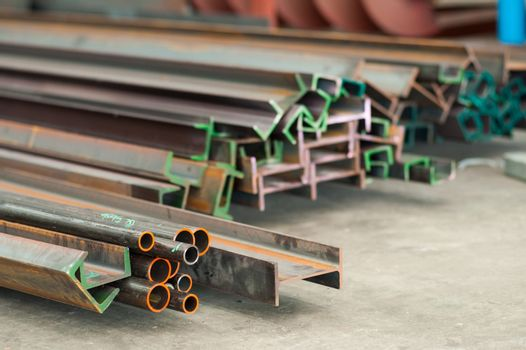 Steel profiles of different dimensions and shapes. Very shallow depth of field with the end of the bottom left profiles in focus.