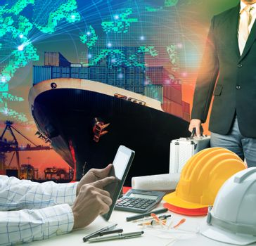 working man and investor against container ship in port use for import export freight cargo and logistic business