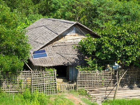 Traditional house made from straw in a village along the Kaladan River in the Rakhine State of Myanmar.