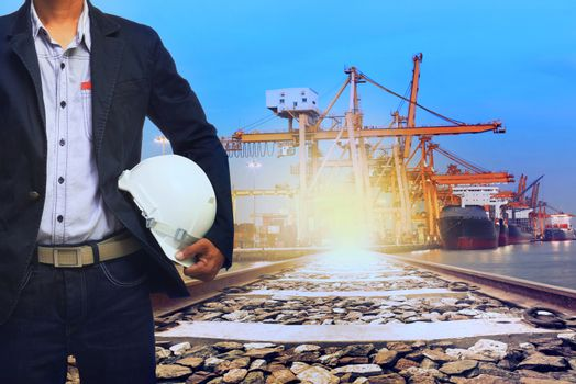 working man in port shipping transport and train land logistic use for transportation industry background