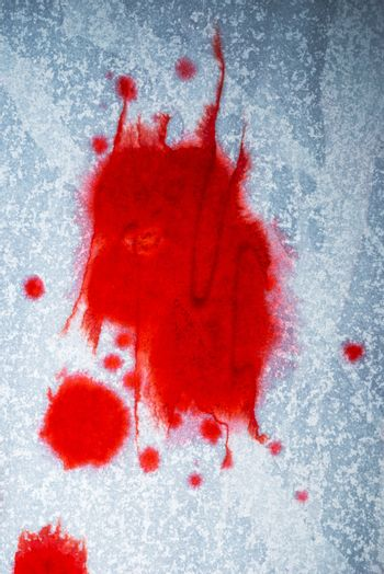 Blood stains on white paper