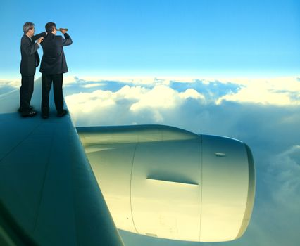 two of asian business man standing on jet plane wing over white cloud and blue sky for business spying strategy
