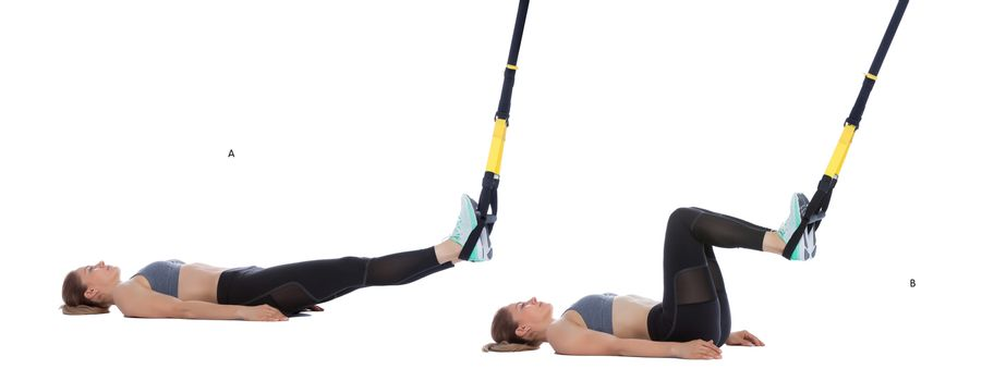 TRX hamstring curl with hips on ground