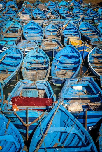 Old blue rusty boats In the Essaouira port, Morocco