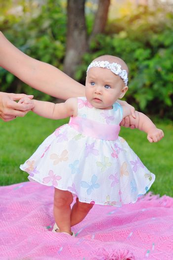 baby girl outdoors in a dress