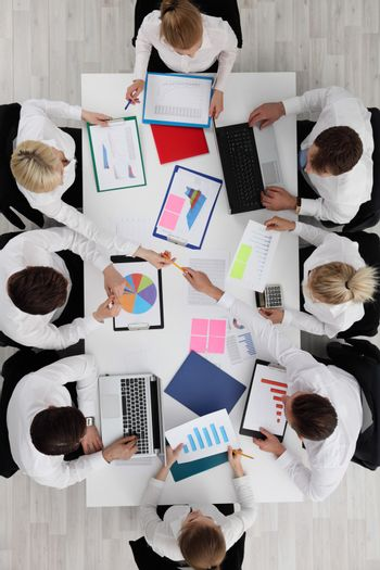 Top view of business people working with financial reports