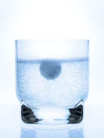 aspirin tablet in a glass of water