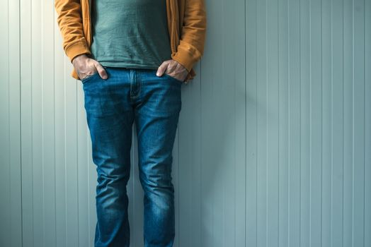 Tall casual man in jeans posing