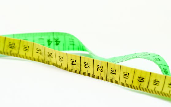 picture of a yellow and green tape measure on white background