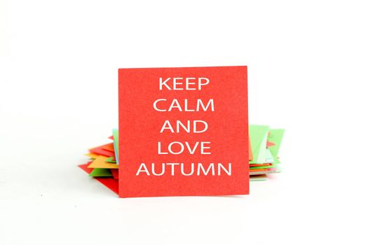 picture of a red note paper with text keep calm and love autumn
