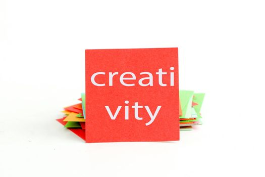 picture of a red note paper with text creativity