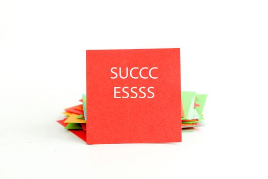 picture of a red note paper with text success