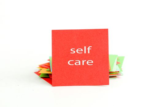 picture of a red note paper with text self care