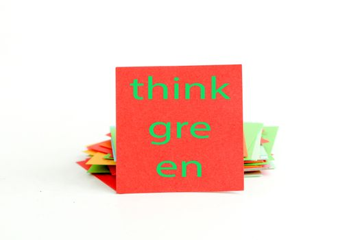 picture of a red note paper with text think green