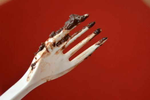 picture of a remains of Dark chocolate cake on a disposable fork