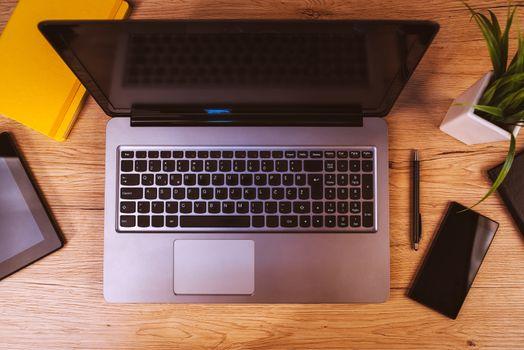 Mobile electronics on business office desktop