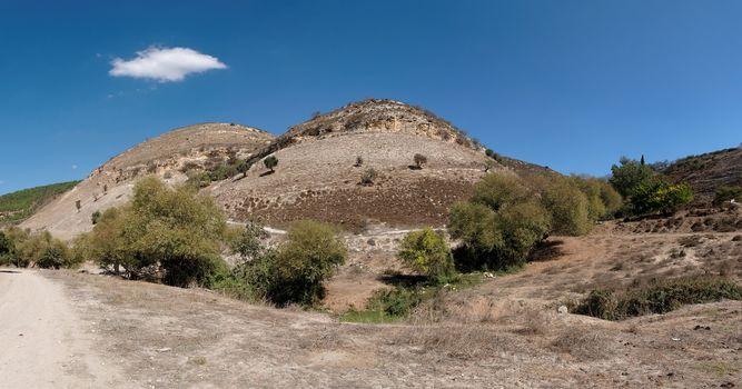 Twin round hills among Mediterranean landscape