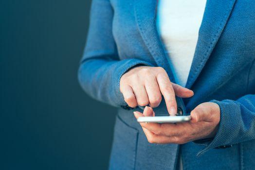 Elegant businesswoman using smartphone