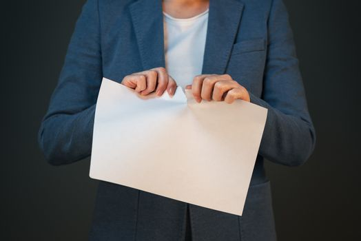 Businesswoman tearing business legal agreement contract