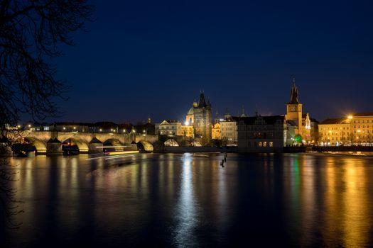 Night photo of Prague Charles Bridge and Powder tower