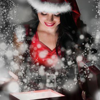 Santa girl opening the magical present