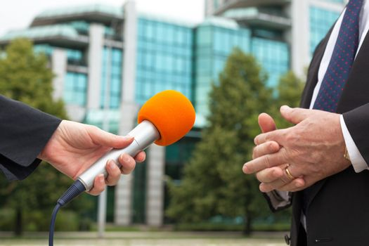 Female journalist conducting an interview with business person or politician