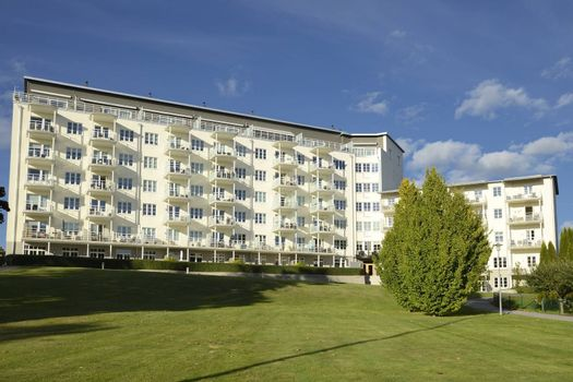 Swedish apartment block with blue sky.