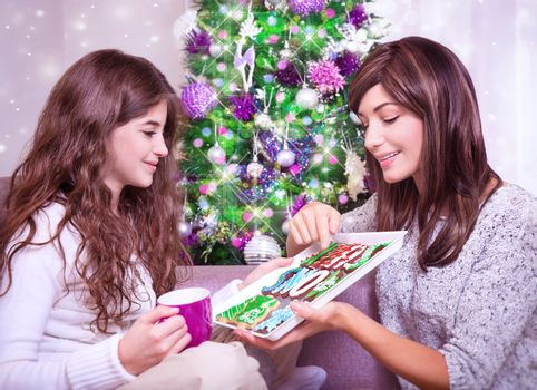 Mother with daughter in Christmas eve