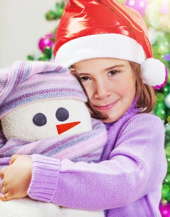 Cute girl with snowman toy