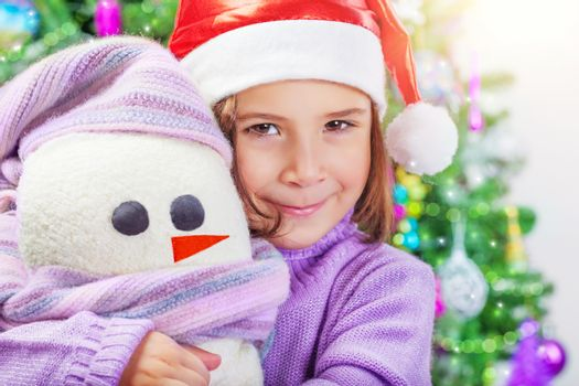 Little girl with snowman toy