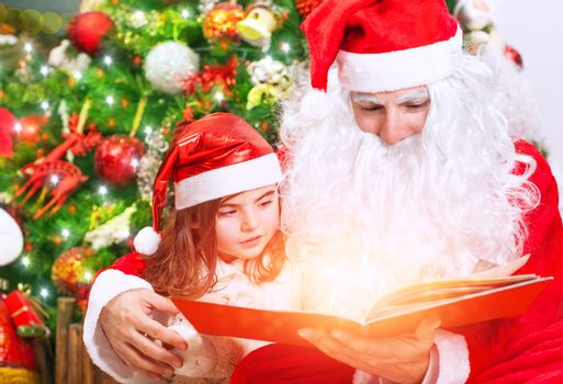 Little girl with Santa read book