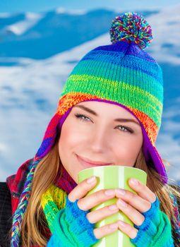 Pretty woman having coffee