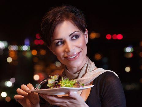 Pretty woman having dinner