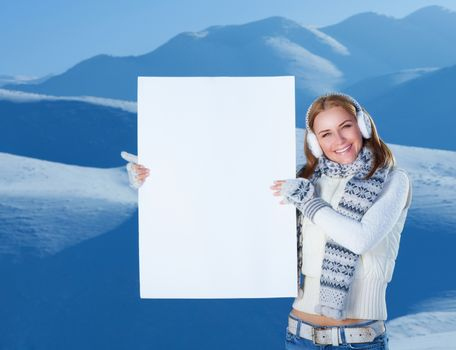Happy woman with blank postcard