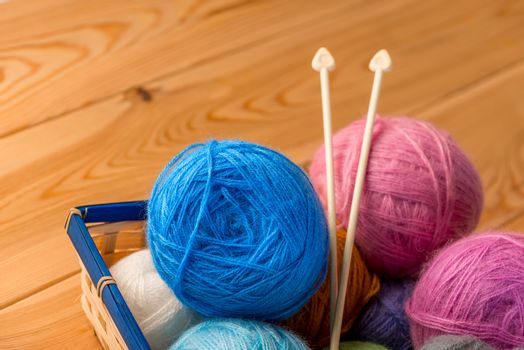 yarn and knitting needles in a basket for hand skill