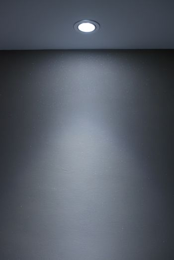 Interior wall and spotlight as background or copy space