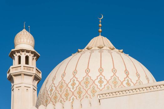 The dome and one of the minarets of the Sultan Qaboos Grand Mosque in Salalah, Dhofar Region of Oman.