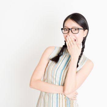 Asian woman laugh and covering mouth