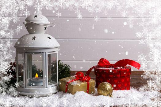 Christmas lantern on snow