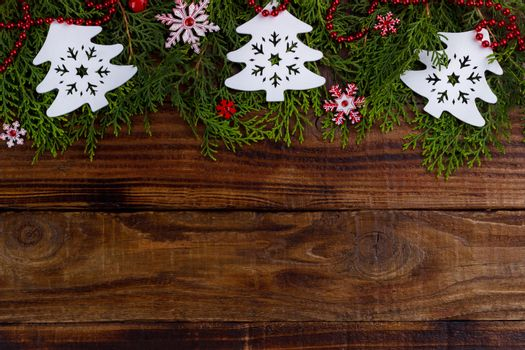 Christmas background. Fir branch with decorations with space for text