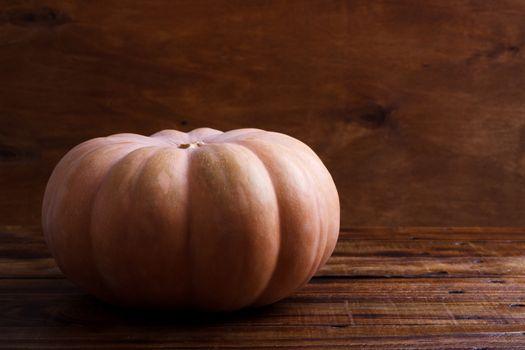 Big pumpkin on wooden background