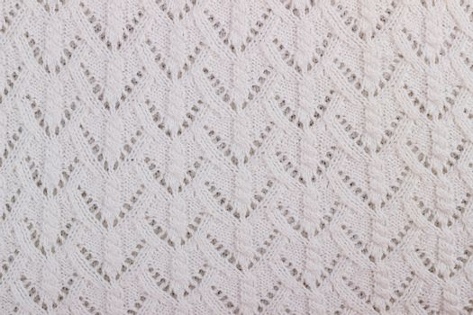 Texture of white knitted woolen fabric for wallpaper and an abstract background