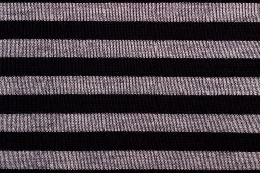 Texture of striped knitted woolen fabric for wallpaper and an abstract background