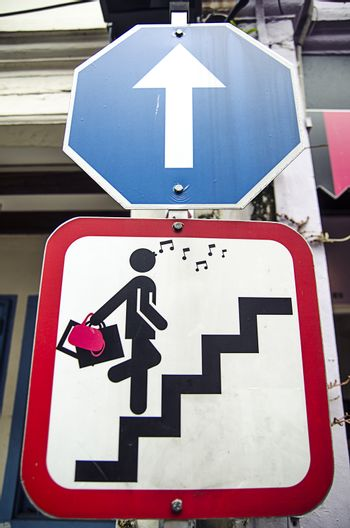 Road sign with glamor woman stair