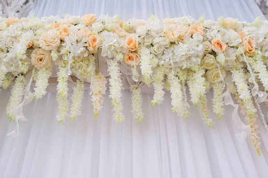 beautiful arch with white roses for wedding ceremony.