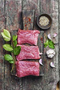 Raw meat steak and seasoning