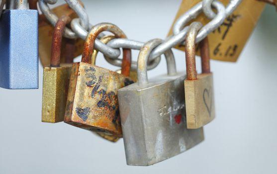 Love locks hanging on a Metal fence of a Bridge
