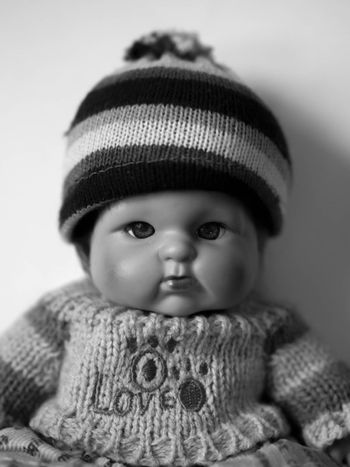 BLACK AND WHITE PHOTO OF PORTRAIT OF A DOLL