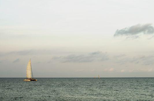 Lonely Sailboat on Horizon