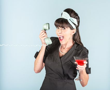 Happy Retro Woman in Black Dress with Cosmopolitan and Phone Rec